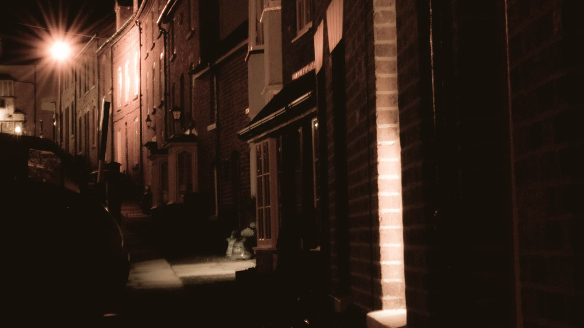 long exposed photo at night of a row of houses