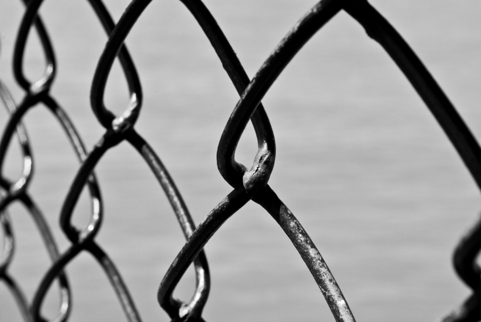 Chain-linked fencing, representing Caledonian Road and urban imprisonment