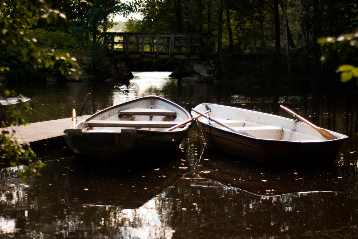 photo of two rowboats on a lake